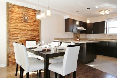 Modern kitchen and dining room with back panel made in horizontal wood strips