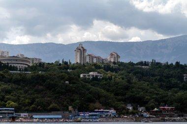 The black Sea coast, on the South Coast, beaches and resorts on the background of the mountain ranges, Crimea, Ukraine