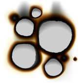 Photo Collection of burnt holes in white paper