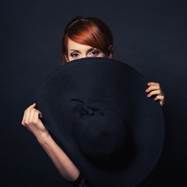 beautiful girl in black dress and hat
