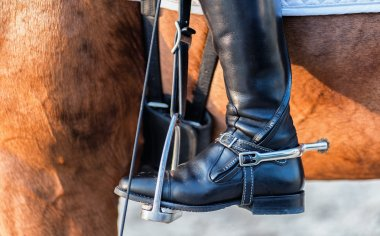 Close up of a boot rider with spurs wheel