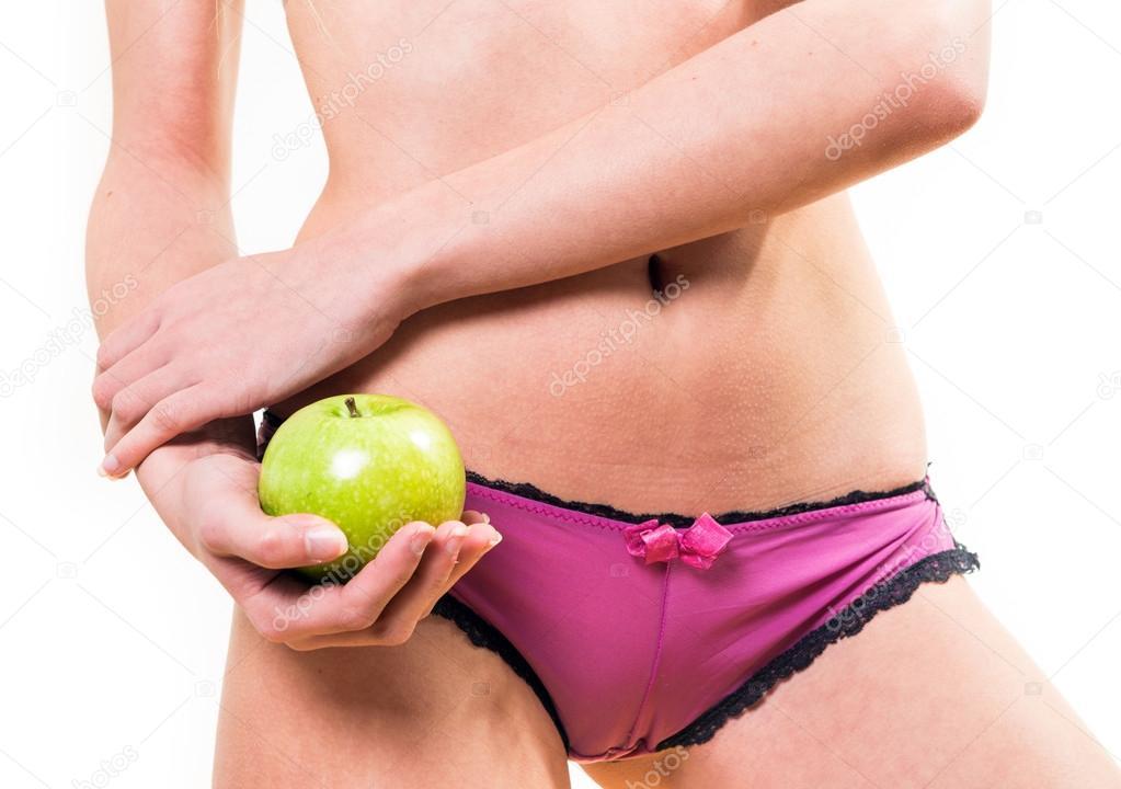 58541e06b488d7 Widok kobiety ładne ciało i jabłko z przodu w ręku — Zdjęcie od Pixinooo.  Znajdź podobne obrazy