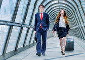 Fotografie Junior executives dynamics in business trip