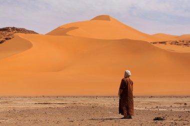 Muslim praying in the desert