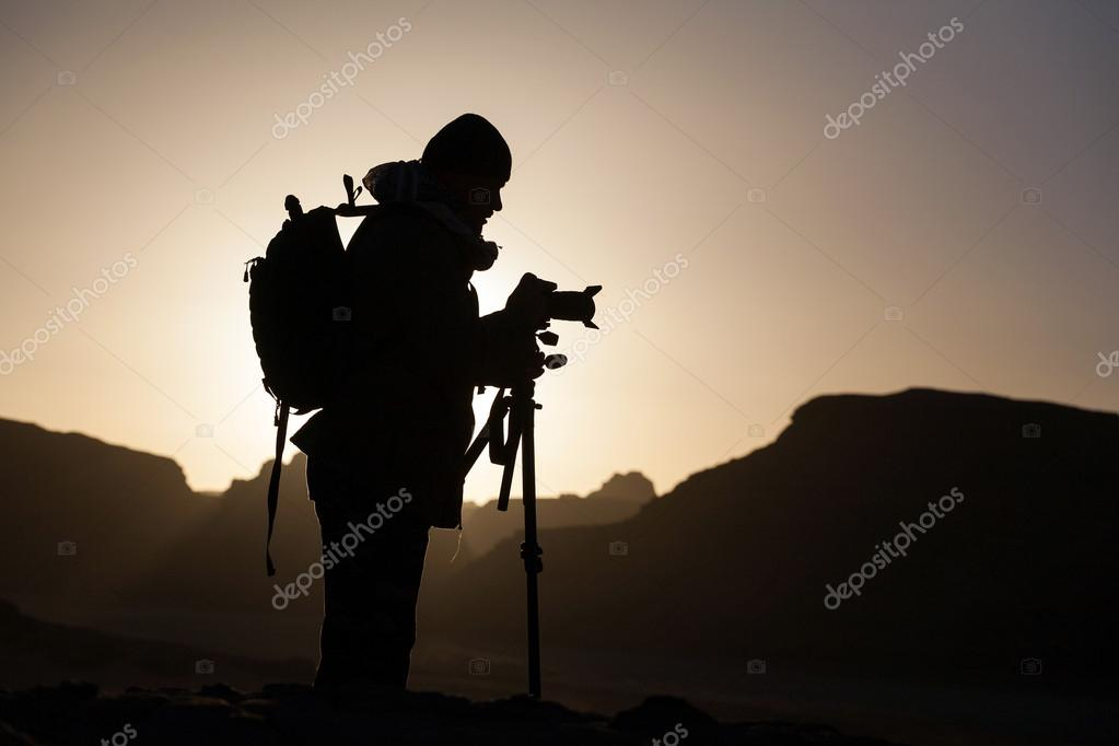 Photographer during sunrise