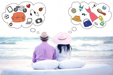 Couple sitting on the beach and thinking about different things