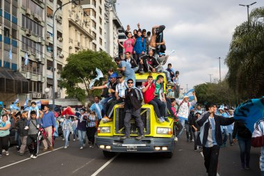 BUENOS AIRES, ARGENTINA - JULY 13, 2014: Soccer fans on the stre