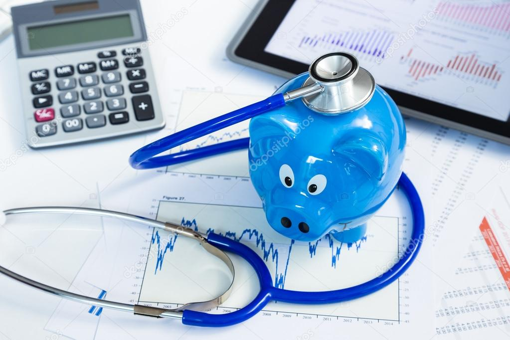 Stethoscope and piggy bank for health insurance concept