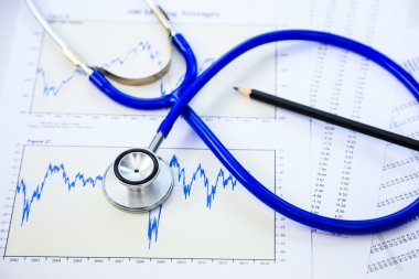 Stethoscope and finance document for financial health check conc