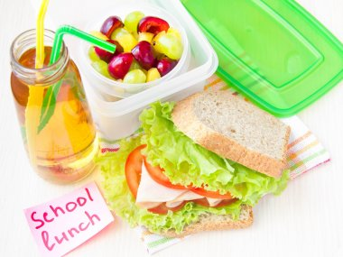 Bento lunch for your child in school, box with a healthy sandwic