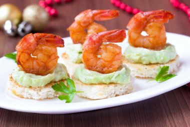 Shrimp on toast with guacamole sauce avocado, Christmas tasty ap