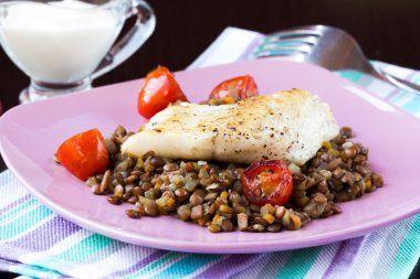 White fish fillet of perch, cod with vegetables and lentils, tom
