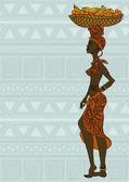 Fotografie Afrikanische Mädchen mit Obstkorb auf dem Kopf