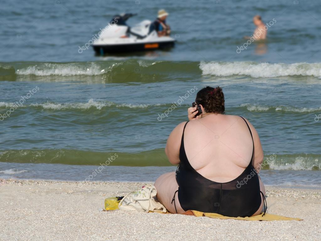 Fat woman on the beach