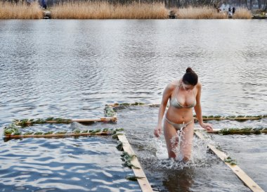 People bathe in the river in winter. Religious holiday of Epiphany