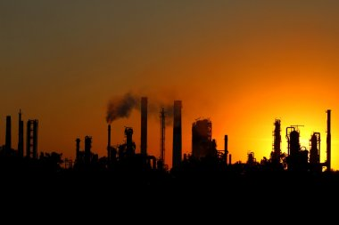 View of crude oil refinery during sunset