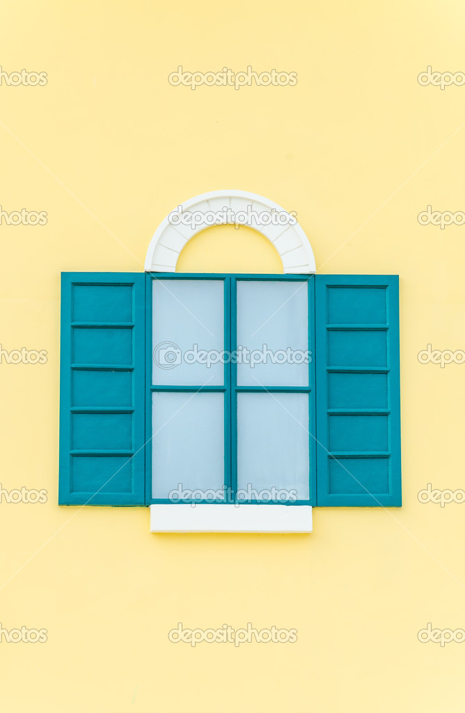 Beautiful window on color wall — Stock Photo © mrsiraphol #33096575