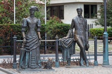 Anton Chekhov and Lady with dog - Monument dedicated to russian writer Chekhov and heroine of the one of his stories, Embankment of Yalta, Crimea, Ukraine