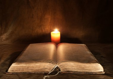Opened Bible and Candle