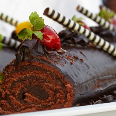Chocolate roll cake with strawberries
