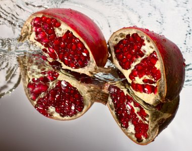Two slices of ruby pomegranate