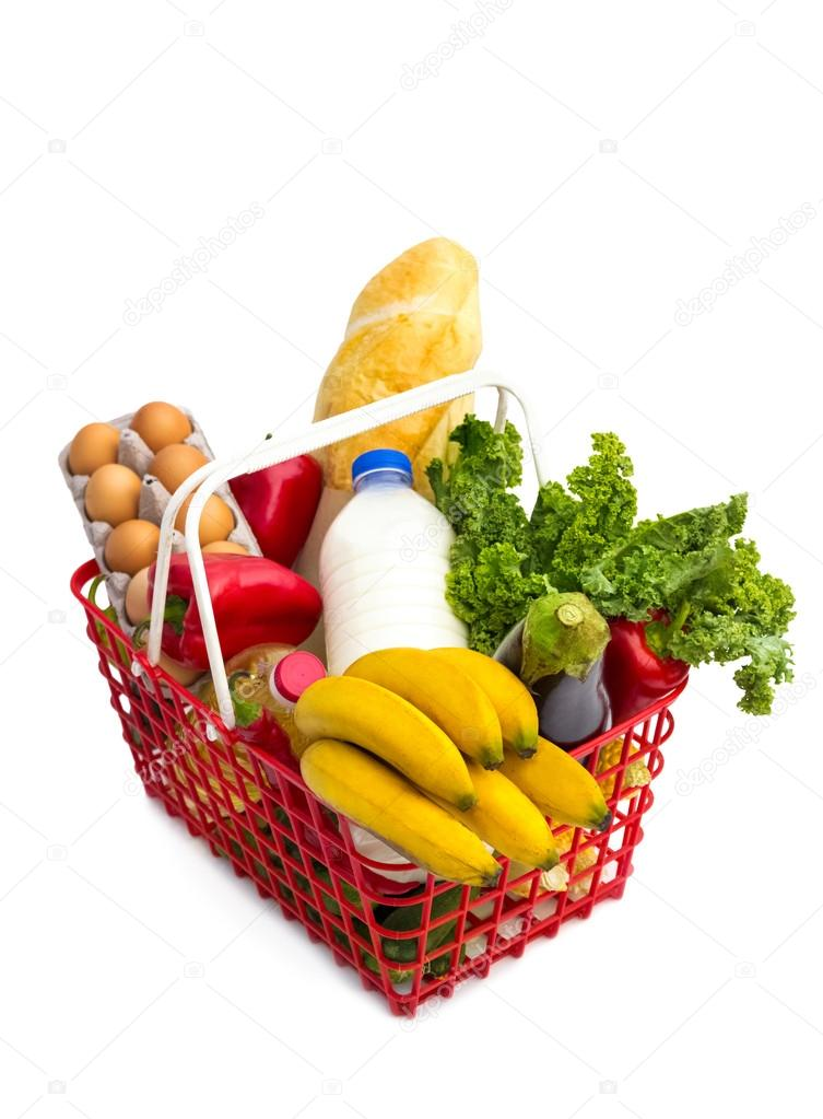 Shopping basket full of fresh colorful groceries