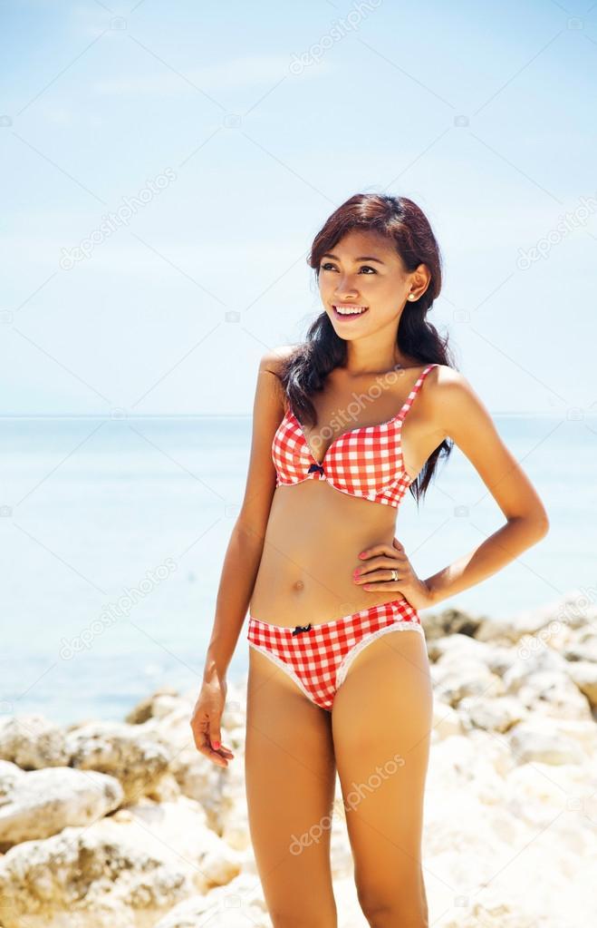 Beautiful asian woman in bikini at sea