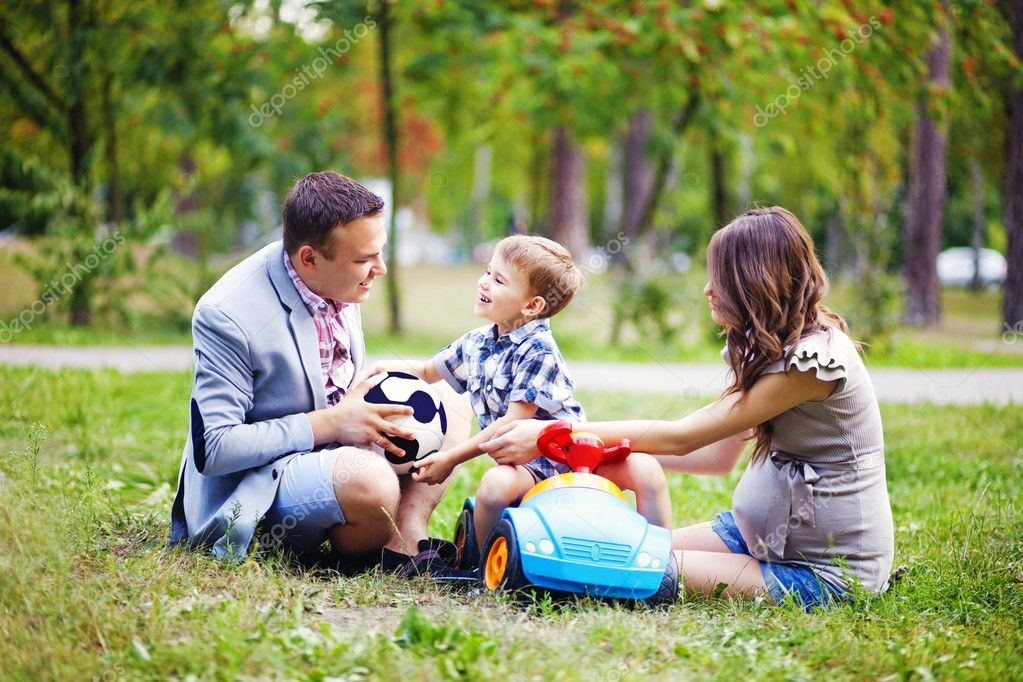 Little boy with family in the park