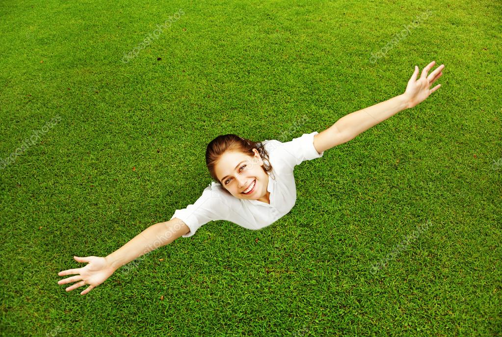 beautiful woman on the grass background
