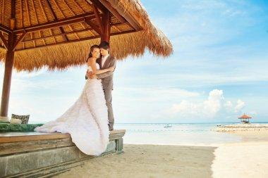 Couple in gazebo on wedding day