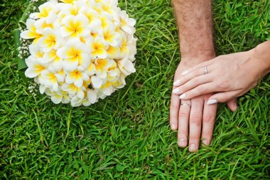 Hands and flowers on wedding day