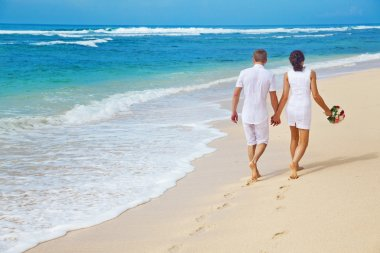 Couple walking on the beach, bali