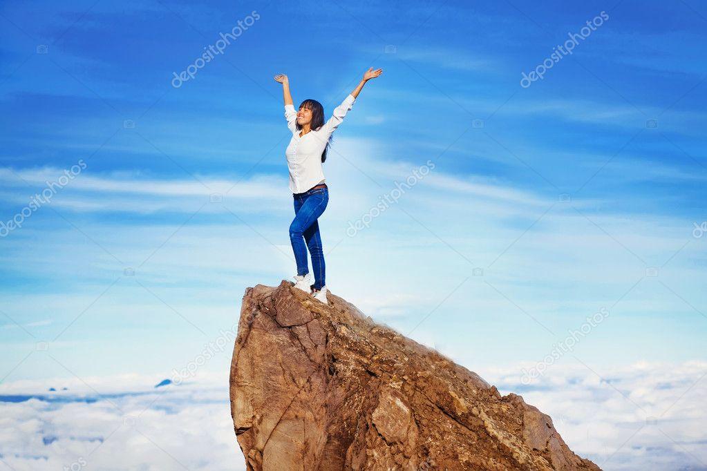 Woman on a mountain peak