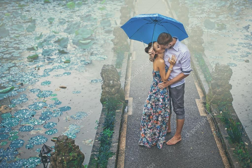 Couple kissing under the rain