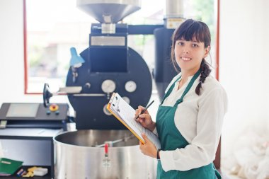 Woman working on coffee factory