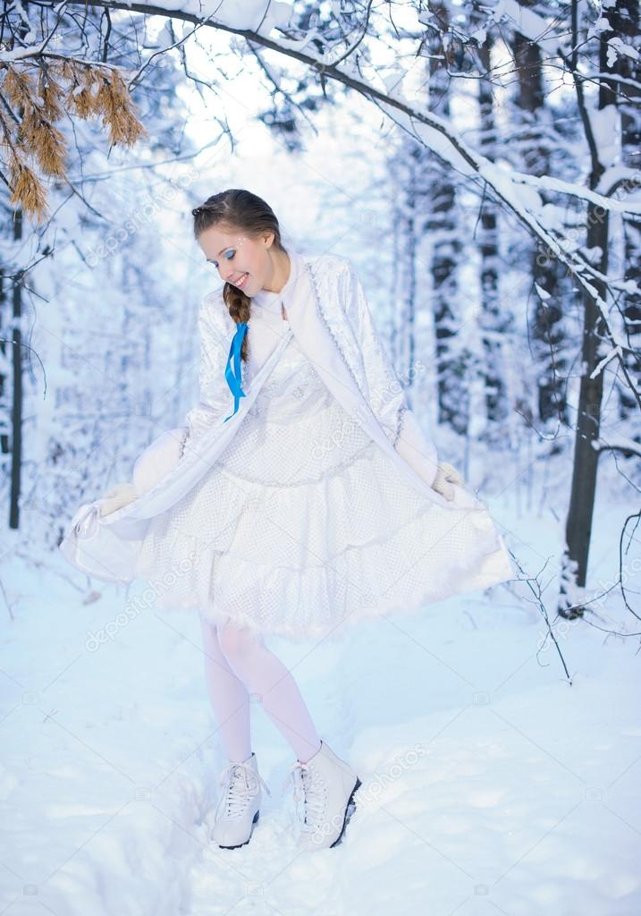 Beautiful girl in a winter forest