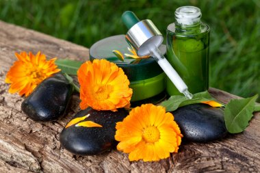 Skin care, serum with orange marigold flowers