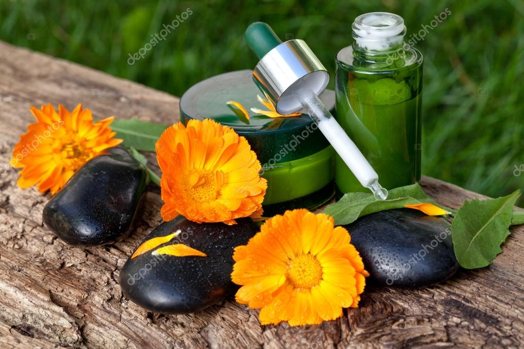 Skin care, serum with orange marigold flowers