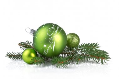 Green christmas balls with fir branch isolated on white