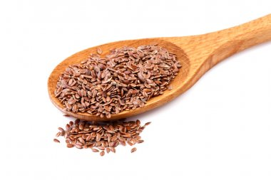 Flax seeds, linseeds on wooden spoon