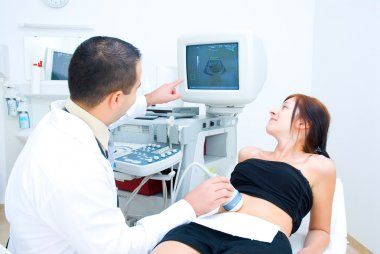 A doctor shows the results of ultrasound examination