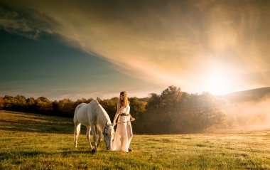 Women with white horse