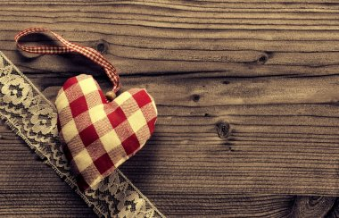 Dotted Fabric heart with lace wood background