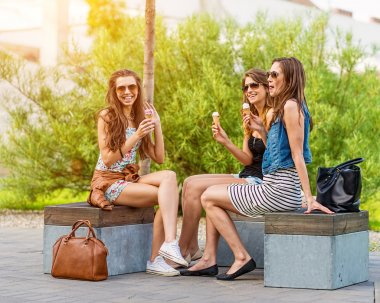 Women chatting on a bench