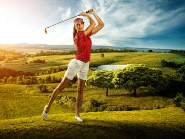 Woman golfer hitting the ball on the beautiful background scenery