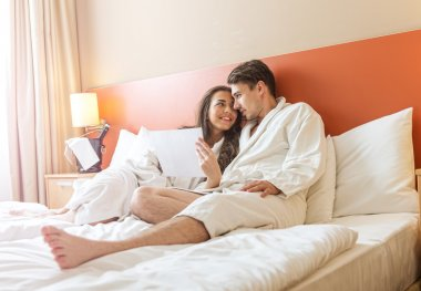 Couple in the bed of a hotel room