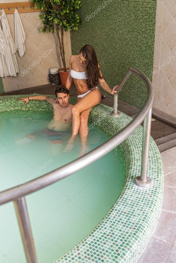 Young Couple In Love In The Pool U2014 Stock Photo #49691383