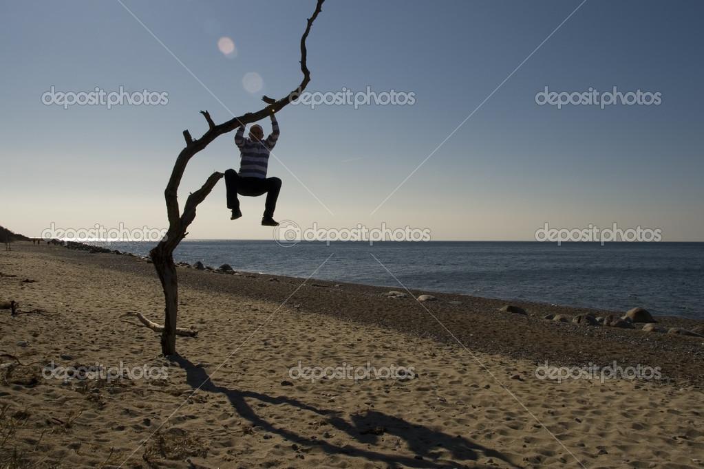 depositphotos_19418373-stock-photo-man-hanging-on-a-tree.jpg