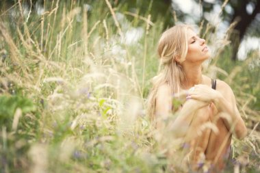 Beautiful young blonde woman in summer