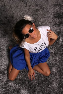 Beautiful Girl Model With Sunglasses on Silver Carpet